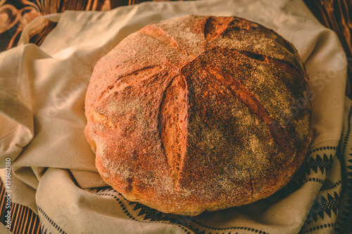 Homemade bread on a wooden background. Style rustic. Poster