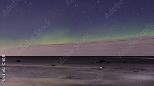 Foto op Plexiglas Aubergine intense northern lights aurora borealis over beach