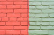 Contrasting colours: green and red dual toned brick wall