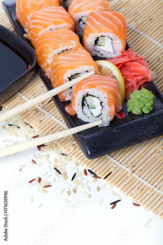 Foto op Canvas Sushi bar Salmon sushi rolls