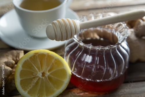 Close up of fresh honey and lemon with ginger tea Poster