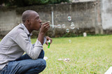 man playing with soap bubbles - 171673591