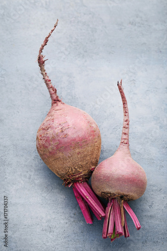 Fresh and ripe beets on grey wooden table