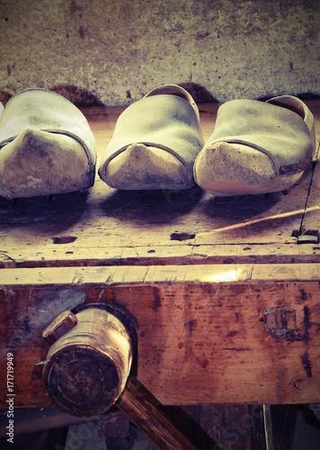 Foto op Plexiglas Amsterdam Dutch wooden clogs made by a skilled carpenter in the carpentry