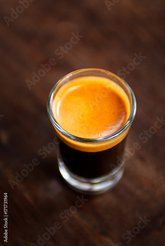 A cup of espresso shot coffee on wooden table background with blank copy space Poster