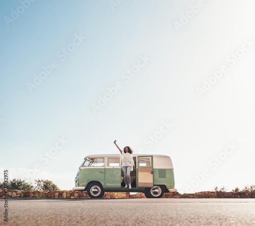 Poster African woman having fun on road trip