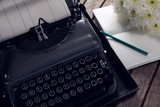 Vintage typewriter, diary and flowers on wooden table - 171755126
