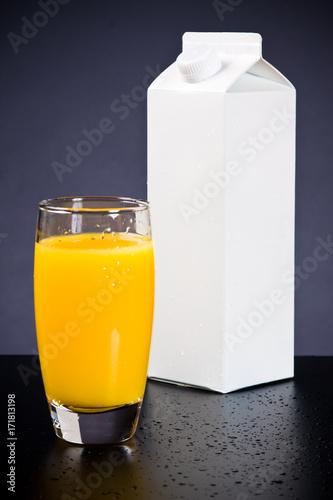 Fotobehang Sap Glass And Carton Of Orange Juice