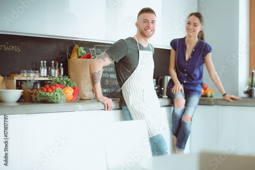 Couple cooking together in their kitchen at home - 171817797