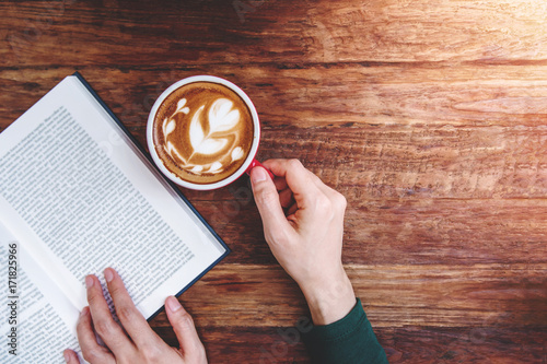 Reading and Relaxing Cozy in Cafe Concept, Focus on Hot Latte Coffee Cup on the wooden table, Lifestyle of Urban People, Top view - 171825966