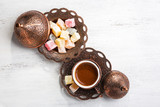 Traditional turkish coffee and turkish delight on white shabby wooden background.  Top view. - 171833314