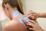 Electro stimulation in physical therapy to a young woman - 171835135