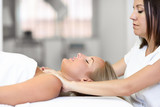 Young woman receiving a head massage in a spa center. - 171835154