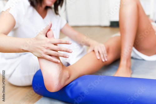 Medical check at the legs in a physiotherapy center.