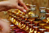 Glass perfume bottles based oils. A Bazaar, market. Macro. Gold and pink gamma - 171841998