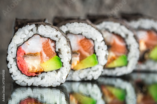 Foto op Plexiglas Sushi bar Sushi roll with salmon, shrimps and avocado