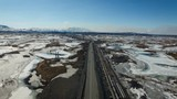 Aerial the View of the Road in the Middle of Industrial Area in the Mountains. North of Russia. Snow, Winter - 171858557
