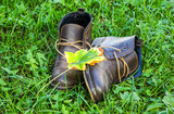Warm men's leather boots on a grass background - 171860324
