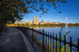 Upper West Side buildings,  Central Park and the Jacqueline Kennedy Onassis Reservoir with fountain in Fall. Manhattan, New York City - 171866762