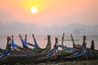 Colorful boats on the shore with sunrise near U Bein Bridge, Taungthaman Lake near Amarapura, Myanmar