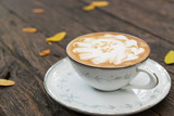 hot coffee with milk cream on wood table - 171871174
