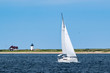 Sailboat with Lighthouse in the background