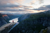Fototapety Alone tourist on Trolltunga rock