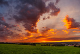 Sunset with clouds and meadow