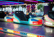 Colorful electric bumper car in amusement park.