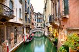 Fototapeta Traditional canal street with gondola in Venice, Italy