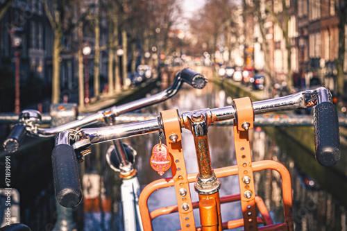 Sticker Orange Bike in Front of a Canal in Amsterdam, Netherlands