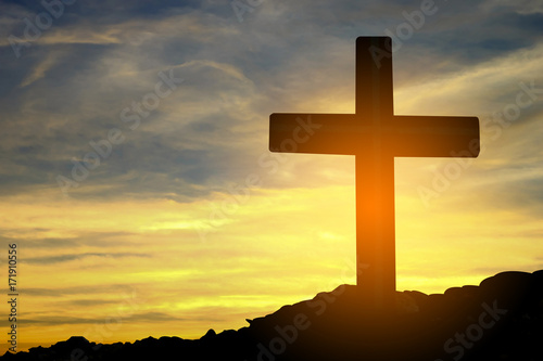 Keuken foto achterwand Zwavel geel Concept conceptual cross religion symbol silhouette in nature over sunset or sunrise sky