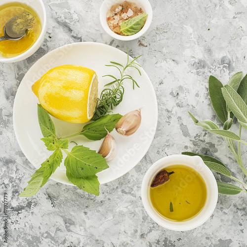 Ingredients for homemade lemon sauce vinaigrette dressing for salad with olive oil, salt, pepper, lemon, lemon zest, juice, garlic and herbs to taste Poster