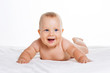 Quadro Cute smiling baby lying on towel isolated on white