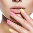 fashion woman with beautiful multicolored nails