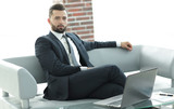 Portrait of a successful businessman sitting in the office lobby. - 171940378