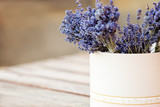 Bundles of dried lavender placed inside round paper box - 171945126