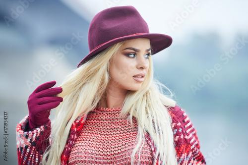 Beautiful blonde woman portrait in autumn city