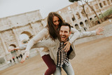 Happy loving couple, man and woman traveling on holiday in Rome, Italy