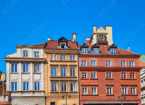 Facades of three buildings in the old town in Warsaw, Poland
