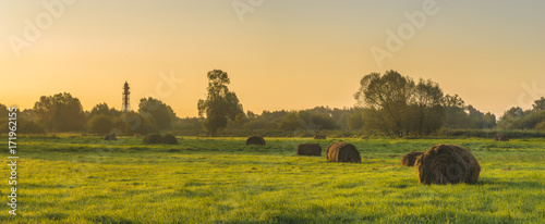 beautiful morning in the meadow, hay bales - 171962155
