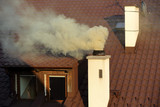 Smoke coming out of the old chimney house - 171965759