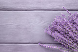 Dried lavender bunches on wooden background. Top view. - 171980378
