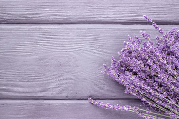Dried lavender bunches on wooden background. Top view.