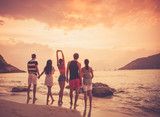 Friends on beach at sunset - 171985737