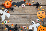 Halloween bats, spiders, ghosts and candies on grey wooden table - 171987979