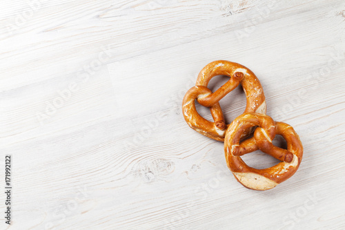 Pretzel. Beer snacks on wooden table - 171992122
