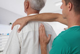 Man having chiropractic back adjustment. Osteopathy, Alternative medicine, pain relief concept. Physiotherapy, sport injury rehabilitation - 171999350