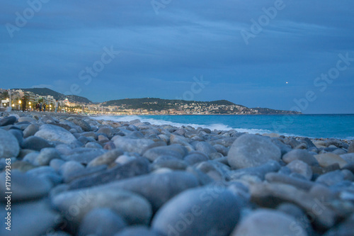 Foto op Plexiglas Nice Beach of Nice, France. Blurred Foreground with pebbles