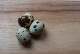 quail eggs on hard wood cutting board - 172034588
